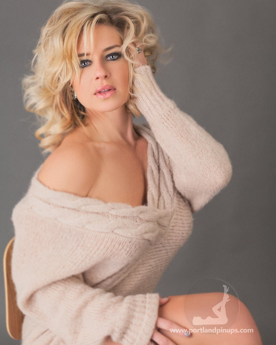 """MONDAYSexy doesn't have to mean naked or lingerie. A simple sweater off the shoulder with that look that says """"come here""""…At Portland Pin-Ups, we believe that EVERY woman is a bombshell, and we love our clients!  We appreciate that visiting a professional photographer is rare these days and thank you for choosing us to capture your beauty.Professional hair styling, make-up artistry, lighting, 20 years of posing experience and industry leading retouching...the Portland Pin-Ups Magic. It's why you don't go to the guy who got a camera for Christmas….For curious photographers:Cameras by Nikon. Lights by Photogenic / Paul C Buff. Posing and artwork by 25 years of experience...."""