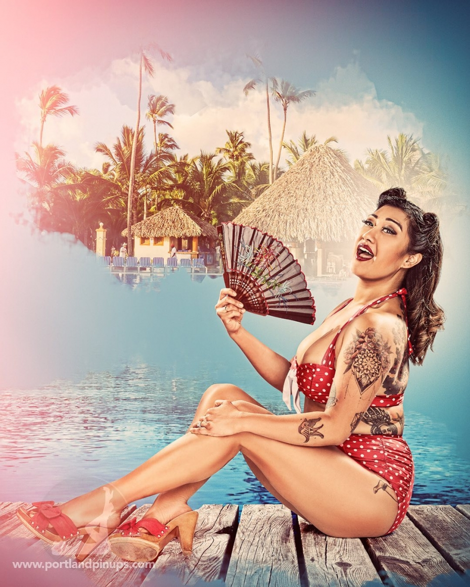 IS IT SUMMER YET?It's cold and rainy in Portland today, so here's the lovely Satheara relaxing by a tropical pool.Stop putting it off. Book a session at Portland Pin-Ups and be a Bombshe!! for a day!At Portland Pin-Ups, we believe that EVERY woman is a bombshell, and we love our clients!  We appreciate that visiting a professional photographer is rare these days and thank you for choosing us to capture your beauty.Professional hair styling, make-up artistry, lighting, 20 years of posing experience and industry leading retouching...the Portland Pin-Ups Magic. It's why you don't go to the guy who got a camera for Christmas….For curious photographers:Cameras by Nikon. Lights by Photogenic / Paul C Buff. Posing and artwork by 25 years of experience....